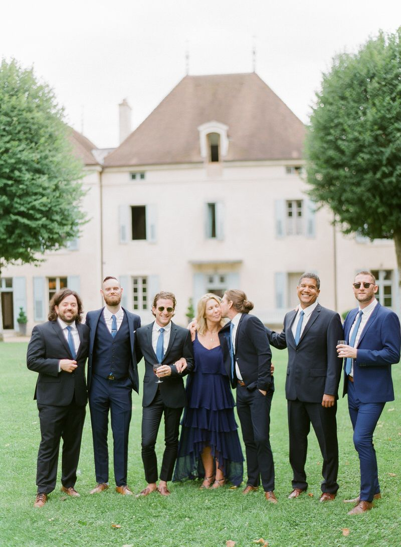 Groom with mom and groomsmen